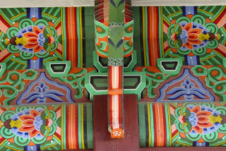Brilliant colors and designs under the eaves of the King's office/private quarters