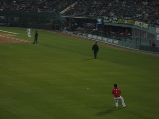 Baseball action--SK player fields a ball in left