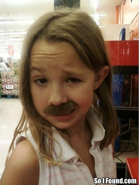 little girl with fake mustashe