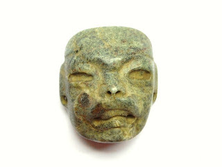 Olmec jade maskette of a were jaguar