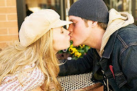 Blonde Girl Intimately Kissing With A Guy