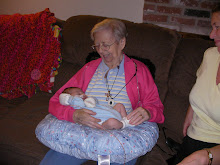 His great grandma holding him
