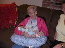 His great grandma holding him