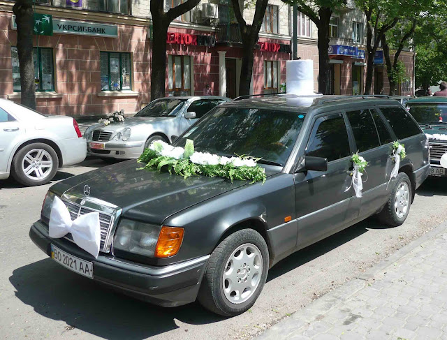 Groom Car Design Wedding Ternopil West Ukraine with white tiebutterfly and