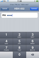 iPhone is pairing with a Bluetooth headset, entering PIN code using iPhone on-screen keypad.