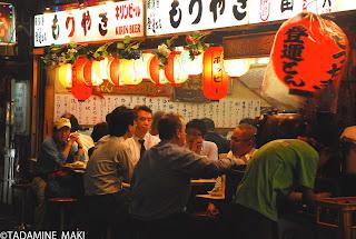 An izakaya, Japanese pub, under a railway, in Shinbashi, Tokyo