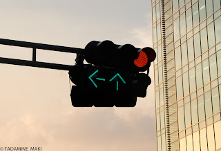 Traffic lights against a modern building