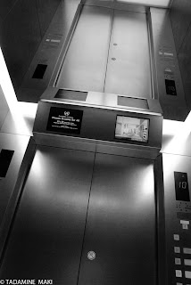An elevator with a mirrored ceiling