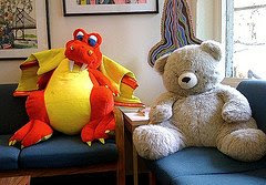 Current reading lounge with large teddy bear and dragon