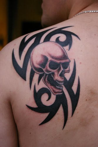 tribal skull tattoos. the tribal skull tattoo