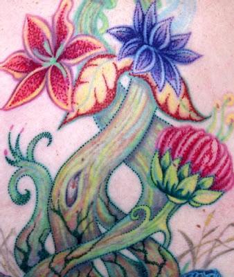 pontilhismo em tatuagem colorido