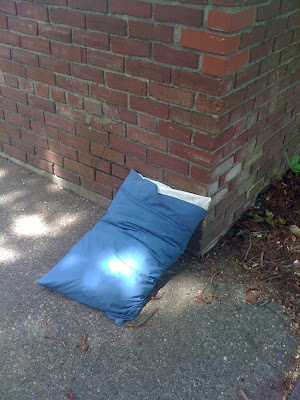 Pillow on the sidewalk