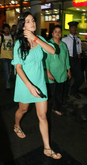 katrina kaif in a short dress ing her legs latest photos