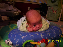 Braden and his tummy time Boppy