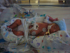 Devin was born at 26 weeks 5 days, and weighed 2lbs 6 oz. he's come so far! we love our bitty baby!
