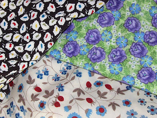 three pretty fabrics I picked up, last Spotlight trip. The black with white splodges has already been turned into a maxi dress. I have BIG plans for the green, and the cream with blue and red was just so divine that I could not pass it up.