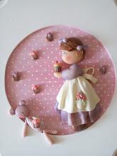 Menina e cupcakes