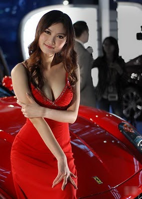 Ferrari Race Queen Flaunts Her Ample Chest