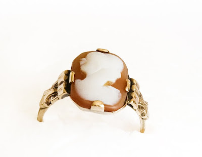 an antique cameo ring of peachy toned coral and white
