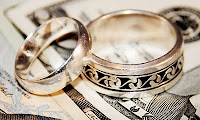 wedding rings on money, copyright Penywise @ morguefile, used with permission