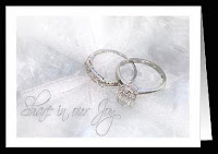 wedding invitation with diamond and white gold wedding ring set on misty background