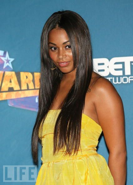 lauren London is wearing a sleek 22 inch weave