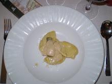 Tortelli di patate con fonduta di caprino , carciofi e olio di nocciola
