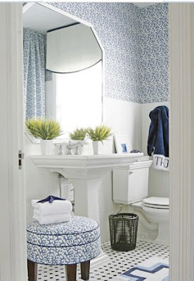Luxury  and blue embellished fabric panels hung from the ceiling create a canopy bed photo via Decorpad Bathroom above in navy and white by T Keller Donovan