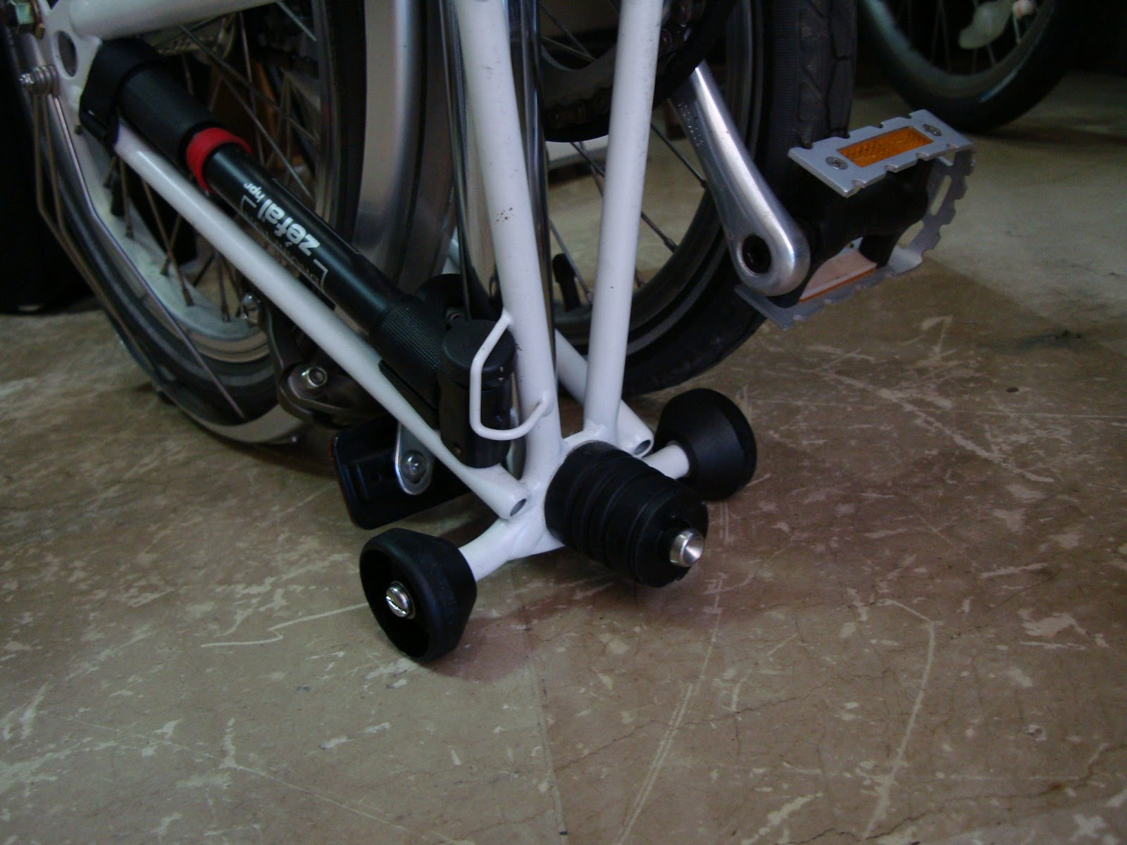 Riding a folding bike around Manila From caster wheels to in line