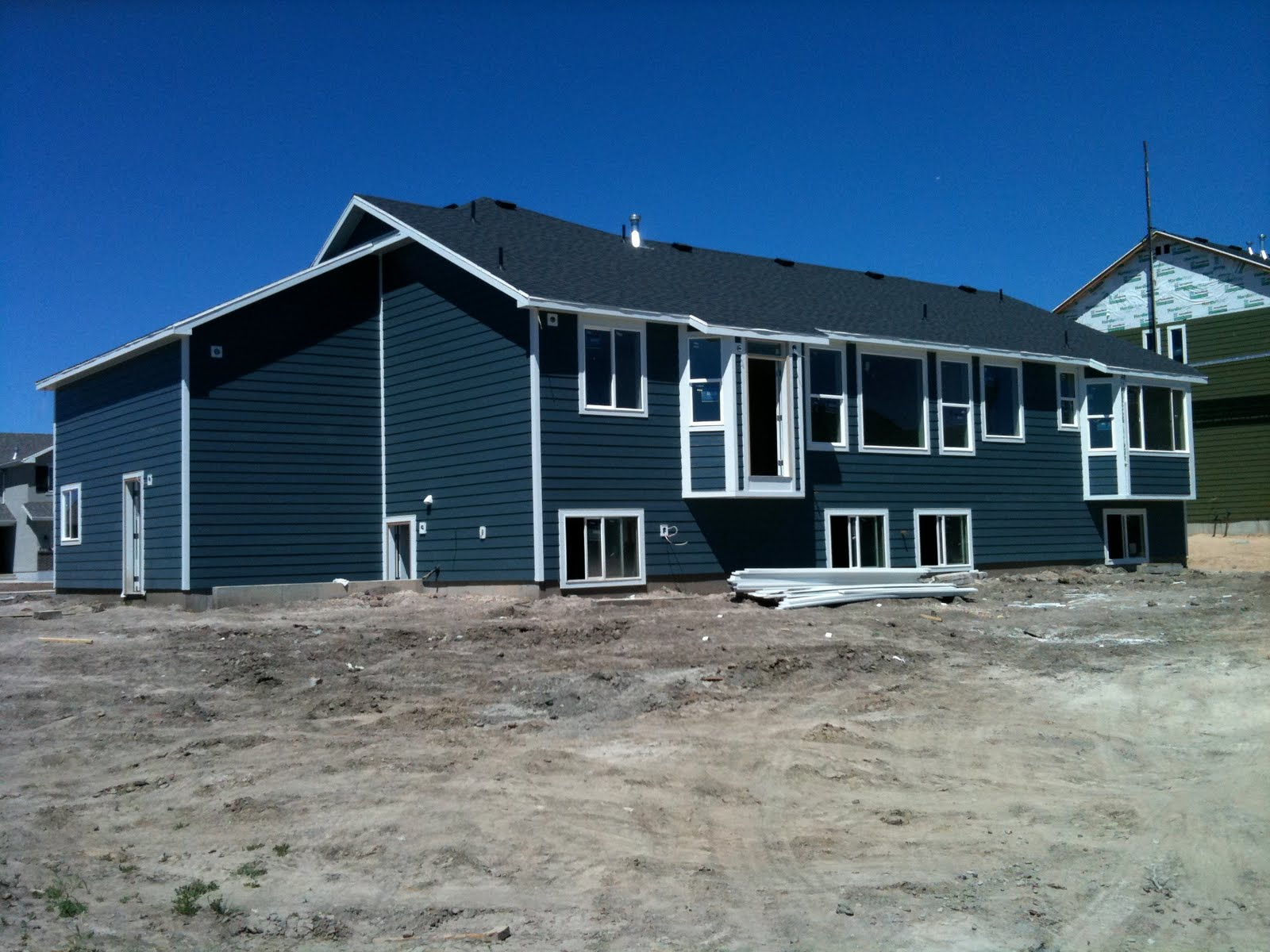 Chapman place new house update for Blue siding house