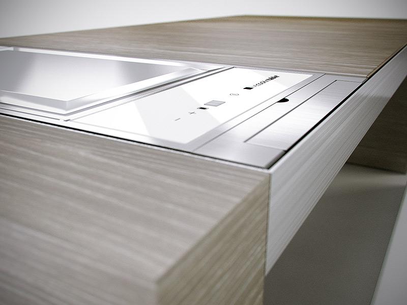 Una cocina integrada en una mesa - Interiores Minimalistas