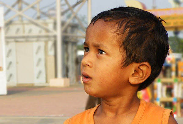 Surprised, child in Kolkata - portrait photography by Sukalyan Chakraborty
