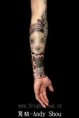 Cute mole tattoo on the arm by Andy Shou