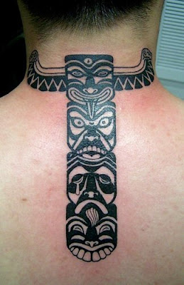 Tribal tattoo behind the neck.