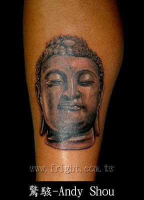 Buddha tattoo on the leg