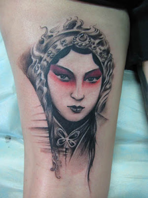 Peking opera portrait tattoo on the arm
