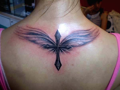 cross and angel tattoo on the back