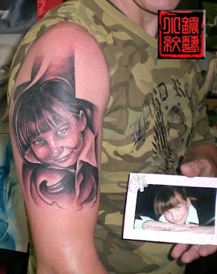 portrait of the daughter inked on his arm