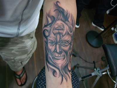 An old man portrait tattoo design on the arm.