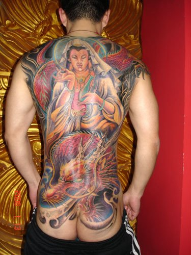 Tattoo of gargoyle wings that cover the shoulder.