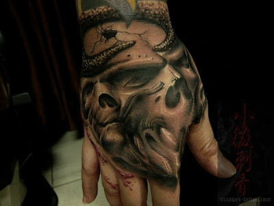 hand free tattoo design, skull tattoo designs This tattoo covers the whole
