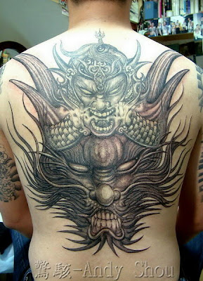 ull back dragon tattoo with two faces