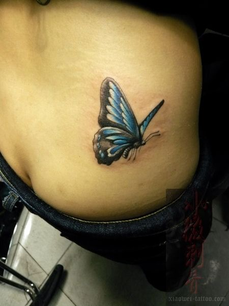 Kisaki has a purple butterfly tattoo~~! I've seen the picture before,