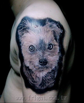 a pet dog tattoo design on the arm