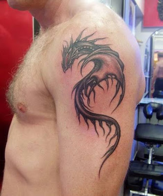 hybrid dragon tattoo design on the arm