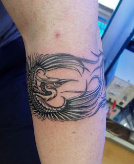phoenix tattoo design on the leg