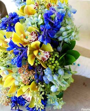 Bridal bouquet designed with orchids, delphinium, brezillia, hydrangea and seeded eucalyptus