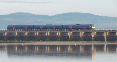 Train crossing Morecambe Bay at Arnside, Cumbria, UK