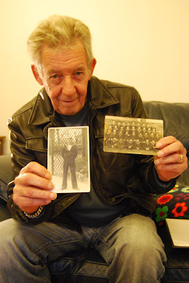 Patrick Dunk with pictures of his brother Walter Dunk who died on HMS Royal Oak in 1939, image by Oliver Gozzard