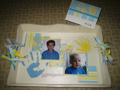 tray with pictures and handprints